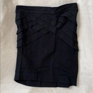 Tight mini skirt with front details